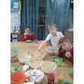 After cooking, Ash class enjoy a sit down meal.