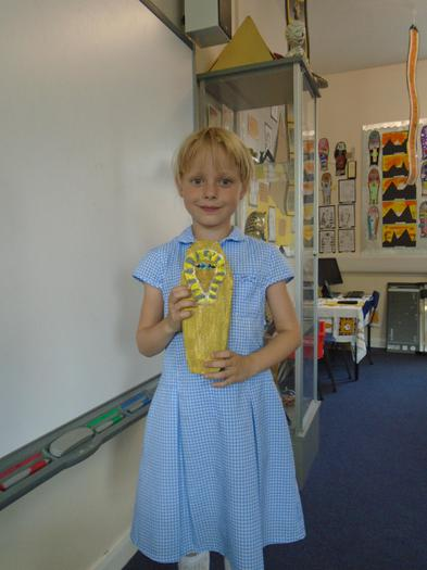 Jasmine proudly shows her sarcophagus.