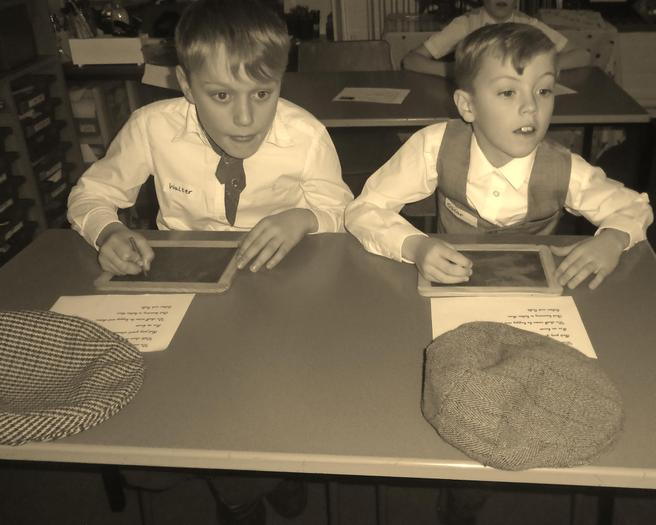 Learning how to write on slate boards.