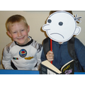 Wimpy Kid (Alfie) reading to an Astronaut