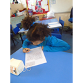 Darcy concentrating on her evacuee letter