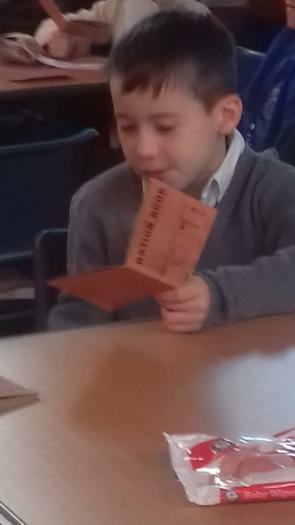 Jacob looking at his ration book.