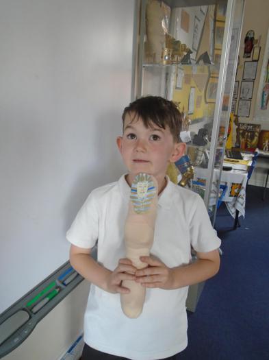McKenzie proudly shows his mummy.