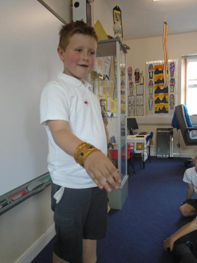 Corey poses with the Egyptian bracelet he made.