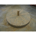 A millstone to grind millet for flour