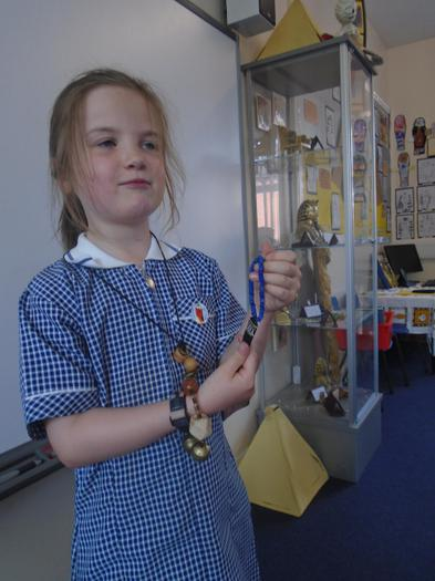 She shows off the Egyptian jewellery she made.