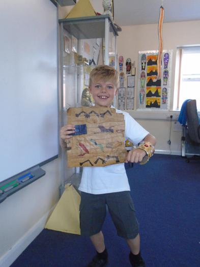 Dominic shows off his bracet and papyrus he made.