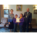 Receiving a silver certificate at the town hall for our school garden and eco awareness.