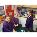 Acting out the moment when John Cross  gave his money for our school to be built.