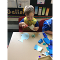 Mason collages to make his rainbow fish