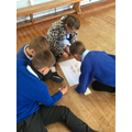 We worked in the hall in groups on our maths problems