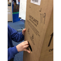 Using clues on the box to work out its contents
