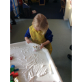 Building winter castles with shaving foam.