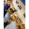 We have been making our own cakes in the home corner!