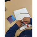 We looked at how to make whole numbers from tenths and hundredths.