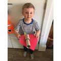 Alfie has made an aeroplane! Zooooom!