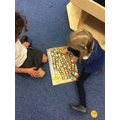 Number recognition and turn taking.