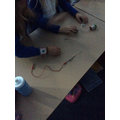 We experimented with electrical circuits, adding lights, switches and buzzes.