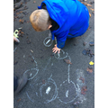 We love using chalk to mark make in the outdoor area! This child drew his very own poppies