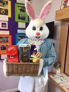 Easter bunny shares out eggs