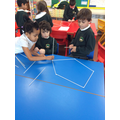 Working in groups to make 3D shapes.