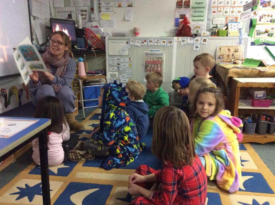 Oak class enjoying a story with Mrs Bowden