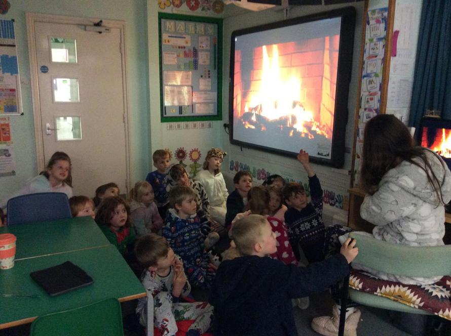 Rowan class enjoying a story with Miss Darby