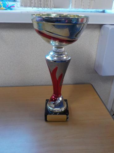 4H won the attendance cup for last term with 97%.