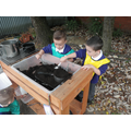 Our mud kitchen is always cooking!