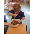 Leo using his muscles to stir the mixture!
