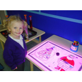 Colouring in Christmas pictures on the light box