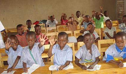 Children involved in writing excercises.