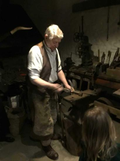 The blacksmith sharpened tools to use in the mines