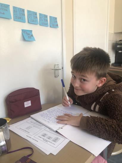 "Nathan has set his own home learning schedule, to include mum's tuck shop at break for a cheese oatcake 😊. At the moment he is completing the topic on the animation ""Tuesday"". writing a story on what the pigs got up to."