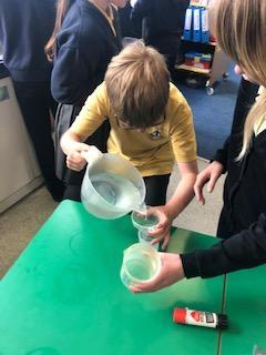 Carefully measuring 50ml of water to test each variable.