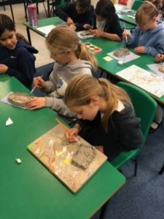 Shaping our Clay designs and carving detail using plastic knives