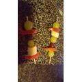 Tyler enjoyed making some colourful fruit kebabs!