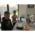 Joshua baking some cakes