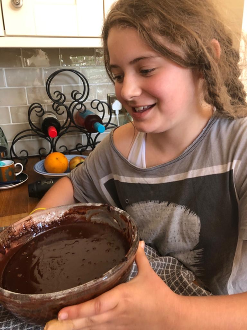 Lola has been busy baking a chocolate cake.