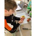Frankie enjoyed preparing his fruit kebabs.