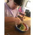 Summer arranging her fruits very carefully...