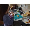 Sophie preparing her delicious fruit