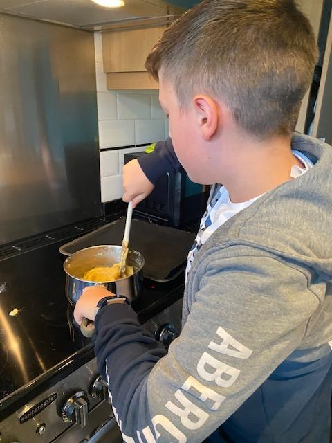 Dylan cooking his creation.