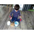Using chopsticks and Yoghurt pots to make music !