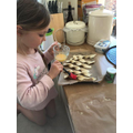 Ida making cheese twists - yum!