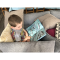 Oliver read a book in his cushion pirate ship