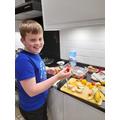 Seb had fun making his fruit kebabs
