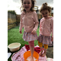 Ruby and Rosie are painting with 'feet'