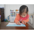 Using crayons to create a picture