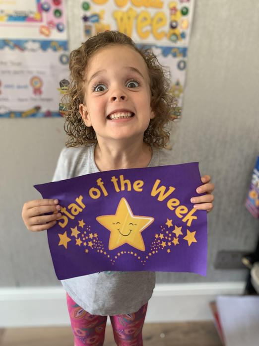 Here is a VERY happy Emily getting her second star